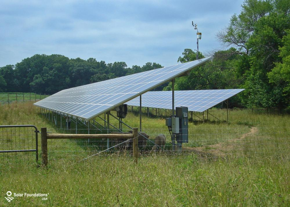 98.7 kW Ground Mount System in Greenville, DE. This featured system is built for (1) 5 panels high in landscape by 32 panel columns wide and (1) 5 panels high in landscape by 52 panel columns wide.