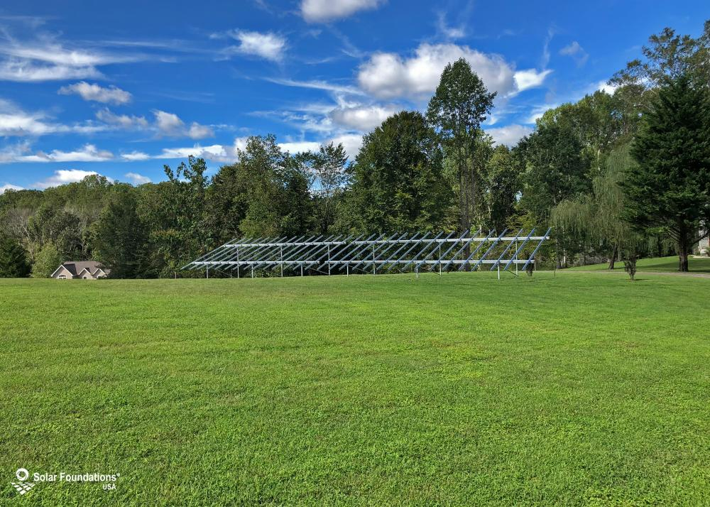 26.55 kW Ground Mount System in Tracys Landing, MD. This featured system is built for (1) 6 panels high in landscape by 7 panel columns wide and (1) 6 panels high in landscape by 8 panel columns wide.
