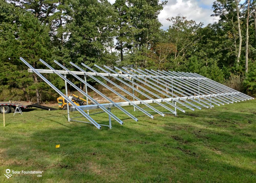 19.8 kW Ground Mount System in Estell Manor, NJ. This featured system is built for (1) 6 panels high in landscape by 11 panel columns wide.