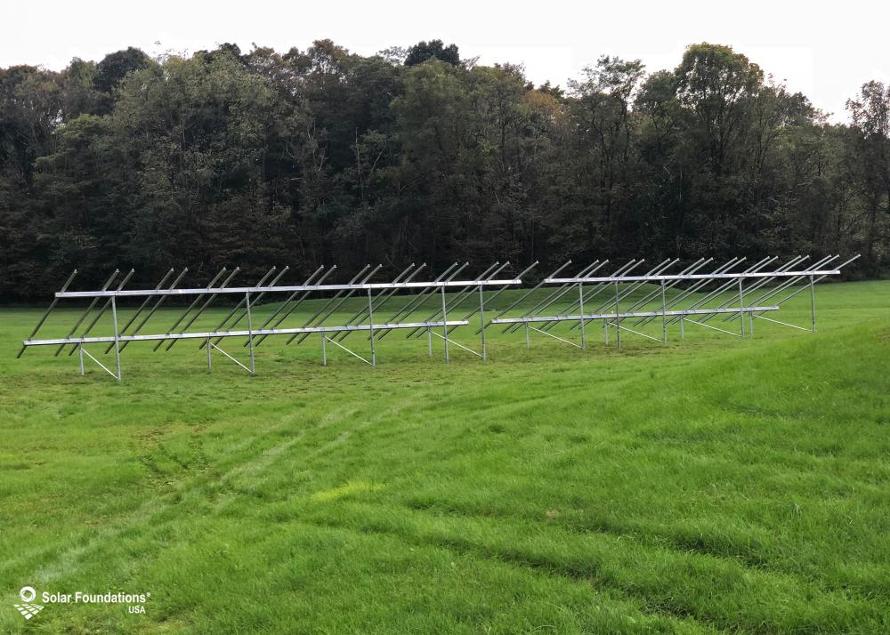 37.62 kW Ground Mount System in Mount Union, PA. This featured system is built for (1) 6 panels high in landscape by 10 panel columns wide and (1) 6 panels high in landscape by 9 panel columns wide.