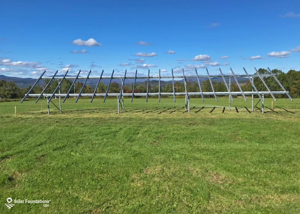 11.6 kW Ground Mount System in North Troy, VT. This featured system is built for (1) 4 panels high in landscape by 10 panel columns wide.