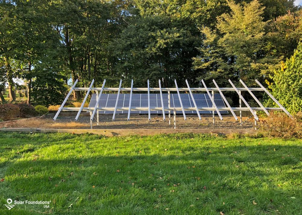 10.08 kW Ground Mount System in Red Bank, NJ. This featured system is built for (1) 4 panels high in landscape by 7 panel columns wide.