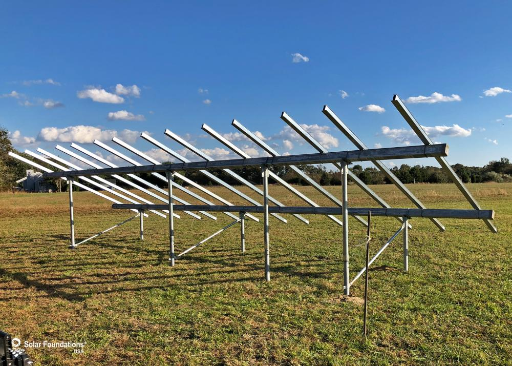 9.1 kW Ground Mount System in Buena, NJ. This featured system is built for (1) 4 panels high in landscape by 7 panel columns wide.