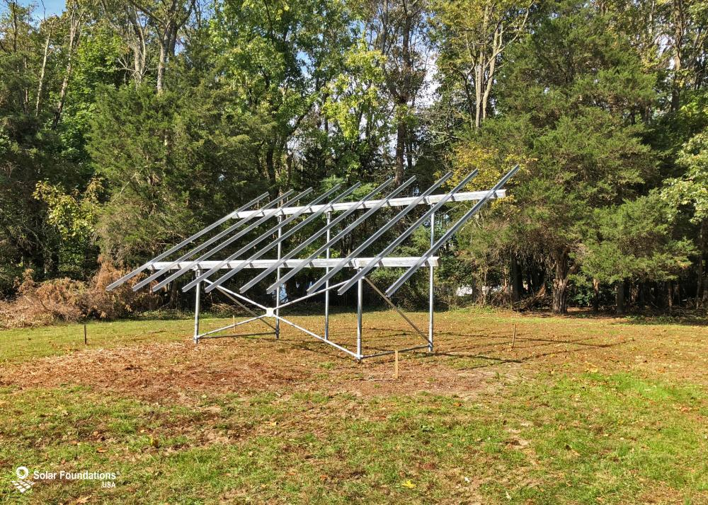 9.0 kW Ground Mount System in Clayton, NJ. This featured system is built for (1) 5 panels high in landscape by 5 panel columns wide.
