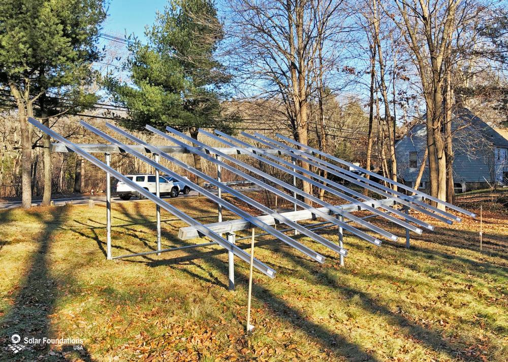 9.0 kW Ground Mount System in Warwick, RI. This featured system is built for (1) 6 panels high in landscape by 5 panel columns wide.