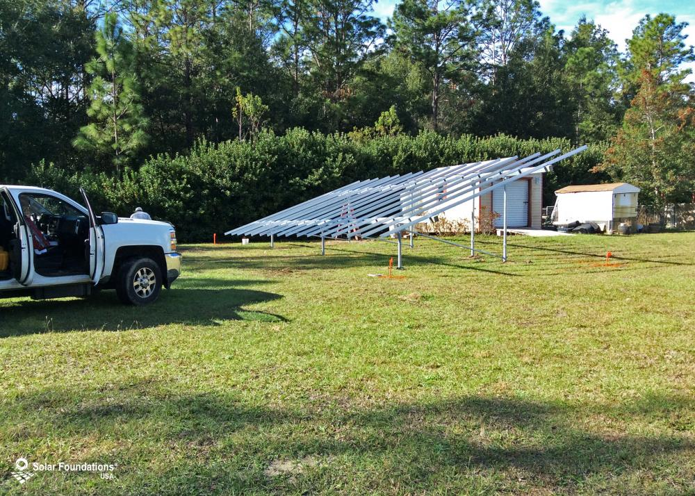13.44 kW Ground Mount System in Dunnellon, FL. This featured system is built for (1) 6 panels high in landscape by 8 panel columns wide.