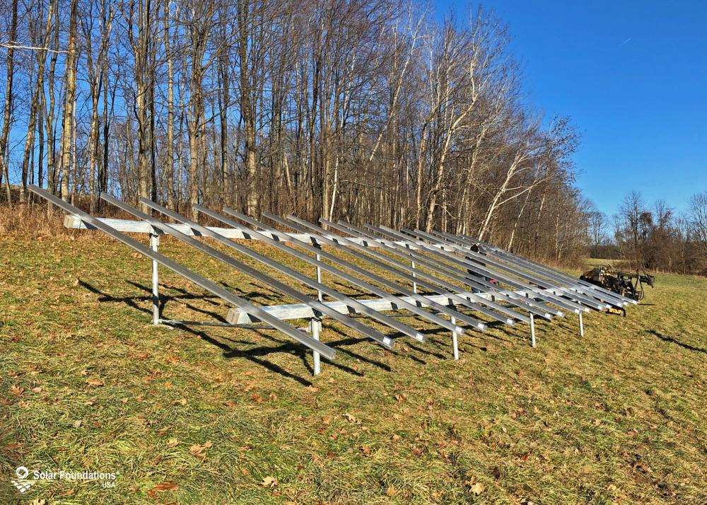 12.4 kW Ground Mount System in Hoosick Falls, NY. This featured system is built for (1) 5 panels high in landscape by 8 panel columns wide.