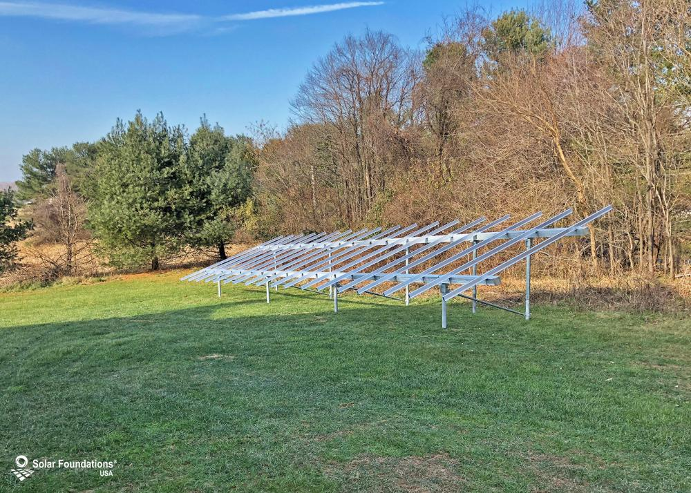 10.44 kW Ground Mount System in Marriottsville, MD. This featured system is built for (1) 4 panels high in landscape by 9 panel columns wide.