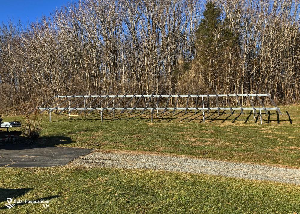 21.6 kW Ground Mount System in Allamuchy Township, NJ. This featured system is built for (1) 6 panels high in landscape by 12 panel columns wide.