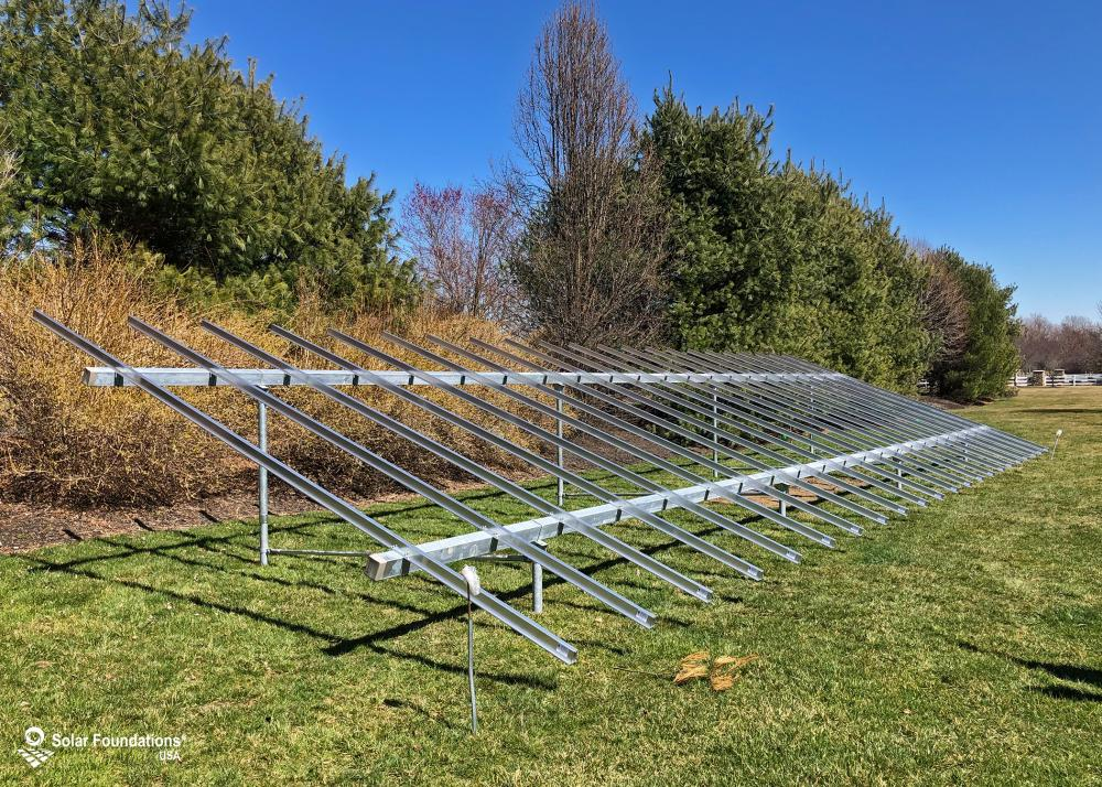 20.46 kW Ground Mount System in Medford, NJ. This featured system is built for (1) 6 panels high in landscape by 11 panel columns wide.