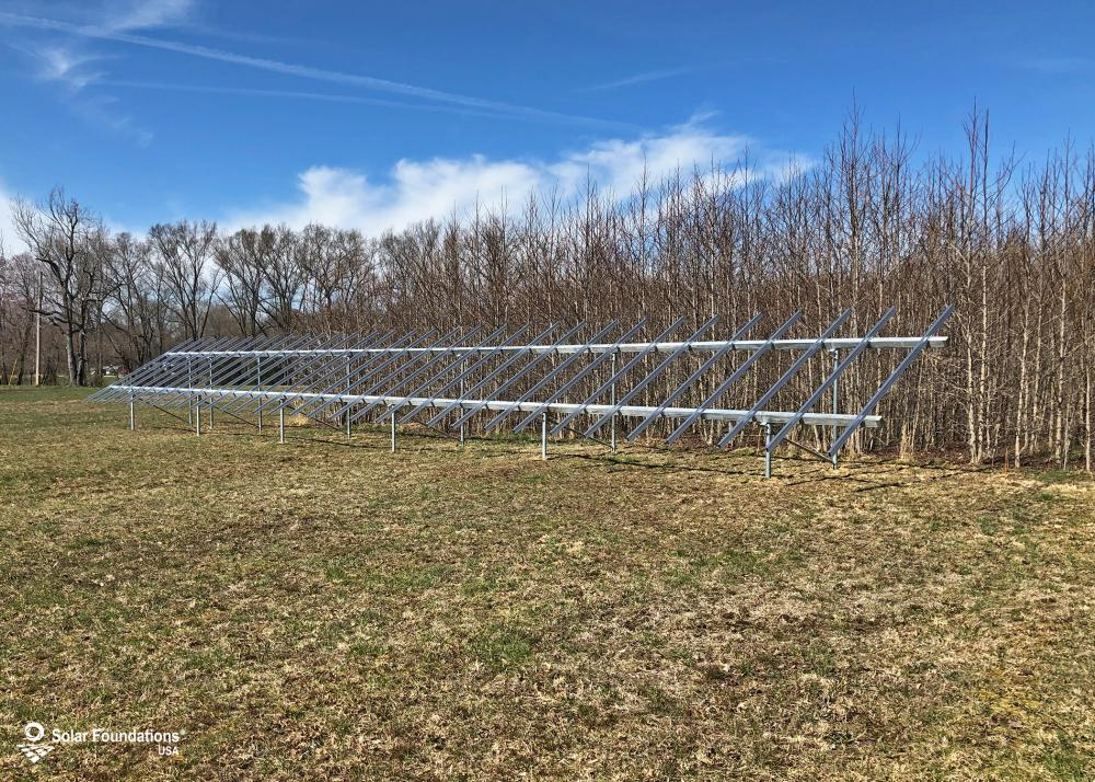 18.56 kW Ground Mount System in La Plata, MD. This featured system is built for (1) 4 panels high in landscape by 16 panel columns wide.