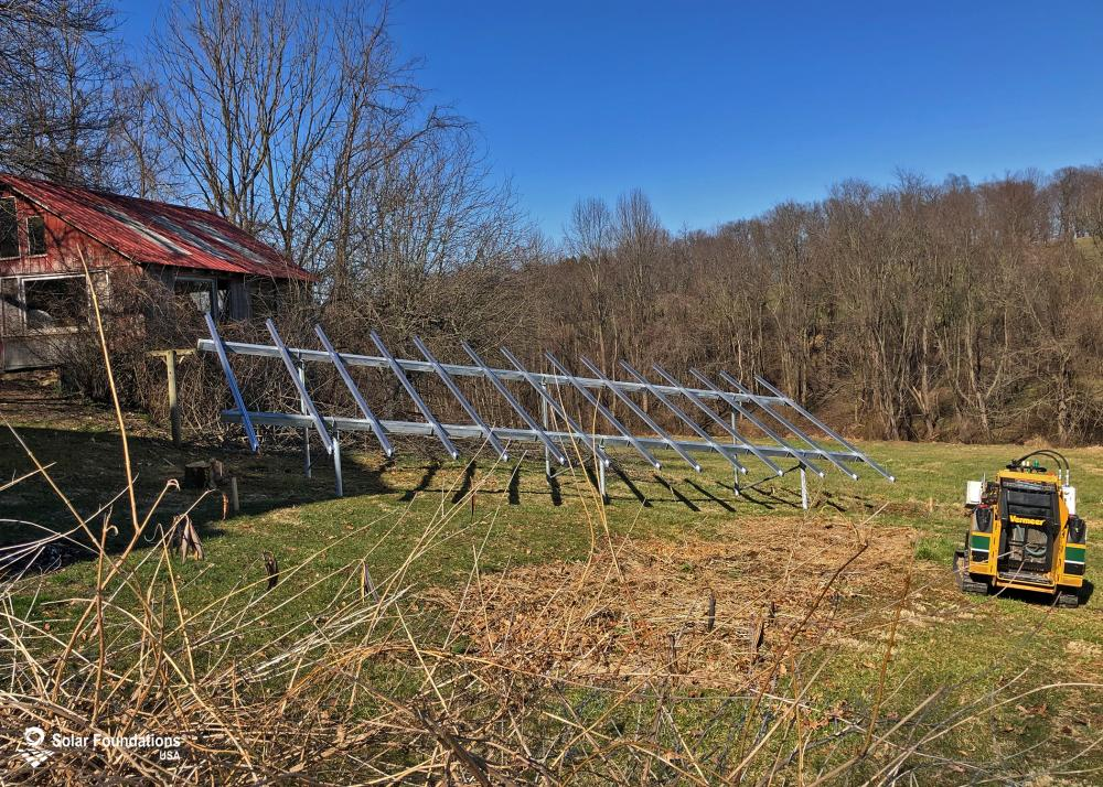 8.12 kW Ground Mount System in Felton, PA. This featured system is built for (1) 4 panels high in landscape by 7 panel columns wide.