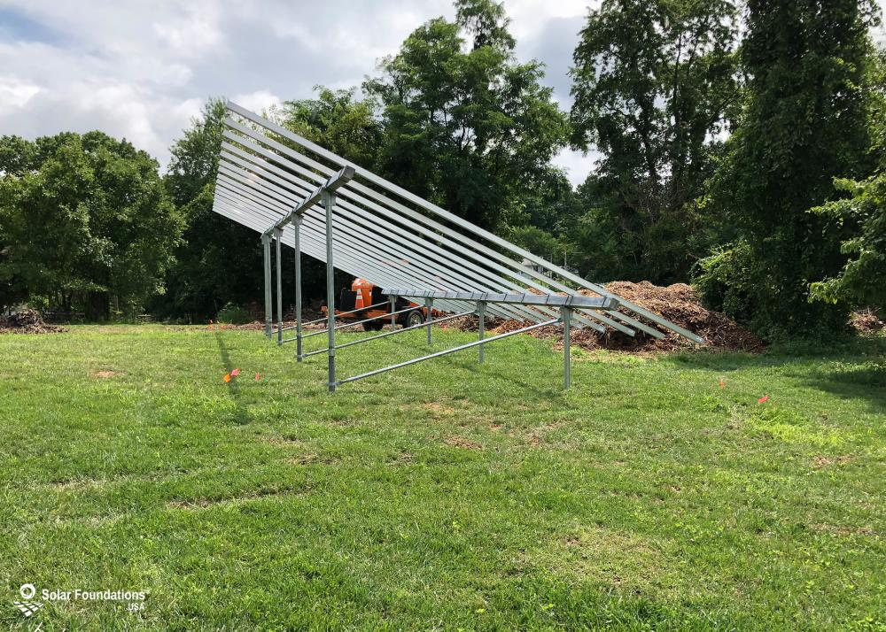 13.68 kW Ground Mount System in Boyds, MD. This featured system is built for 6 panels high in landscape by 8 panel columns wide.