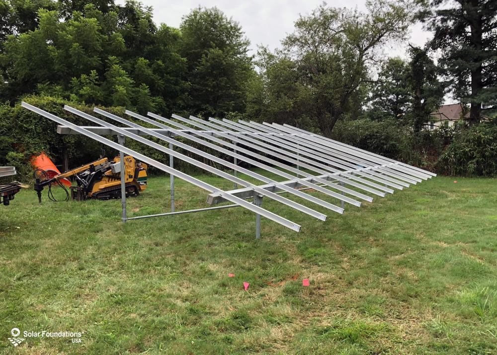 11.97 kW Ground Mount System in Medford, NJ. This featured system is built for 6 panels high in landscape by 7 panel columns wide.