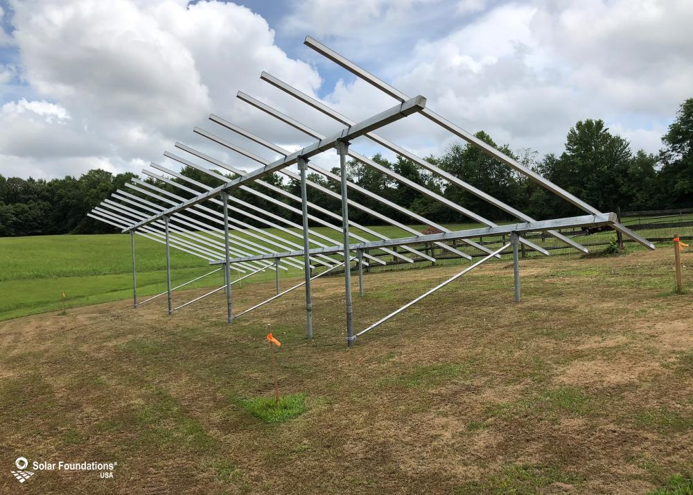16.695 kW Ground Mount System in Woodstown, NJ. This featured system is built for 6 panels high in landscape by 9 panel columns wide.