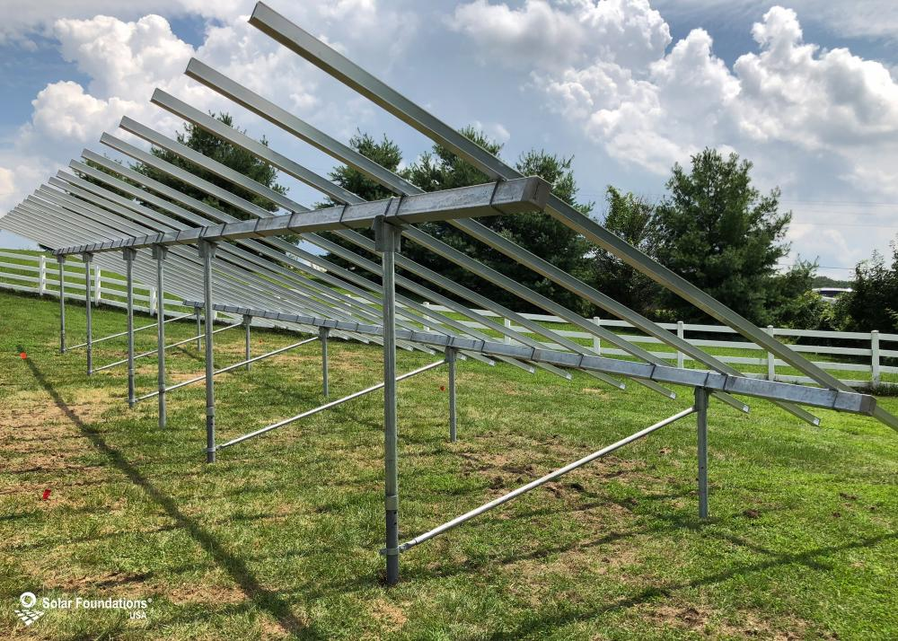 19.47 kW Ground Mount System in New Windsor, MD. This featured system is built for 6 panels high in landscape by 11 panel columns wide.