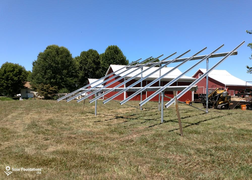 6.36 kW Ground Mount System in Pedricktown, NJ. This featured system is built for 6 panels high in landscape by 4 panel columns wide.