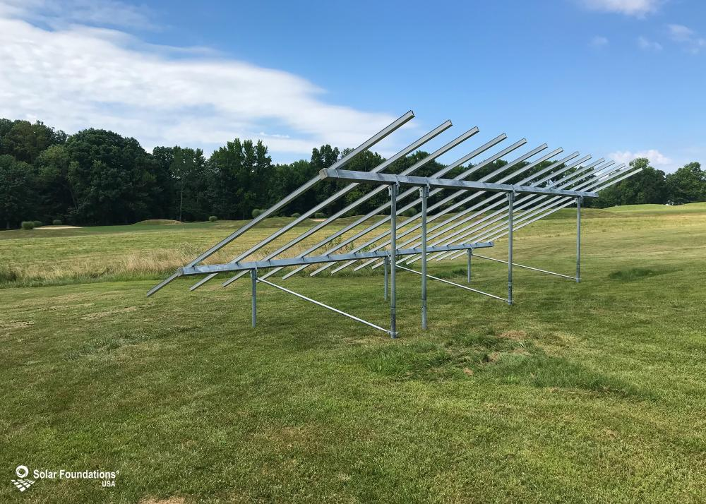 11.97 kW Ground Mount System in Aberdeen, MD. This featured system is built for 6 panels high in landscape by 7 panel columns wide.