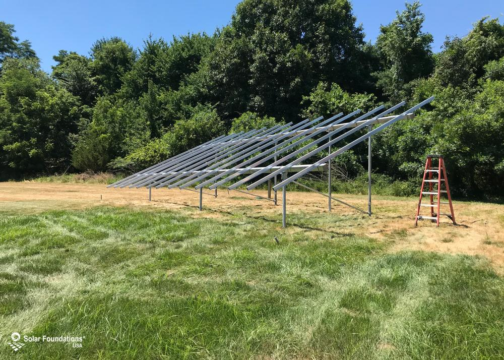 12.6 kW Ground Mount System in Manalapan, NJ. This featured system is built for 6 panels high in landscape by 7 panel columns wide.