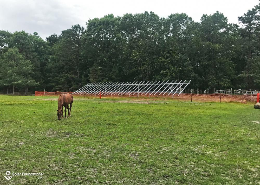 27.00 kW Ground Mount System in Weymouth, NJ. This featured system is built for 6 panels high in landscape by 15 panel columns wide.