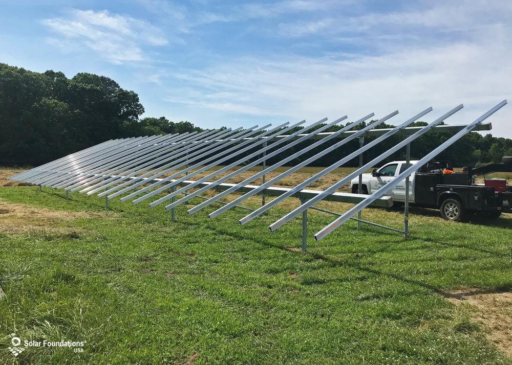25.2 kW Ground Mount System in Pittsgrove, NJ. This featured system is built for 6 panels high in landscape by 14 panel columns wide.