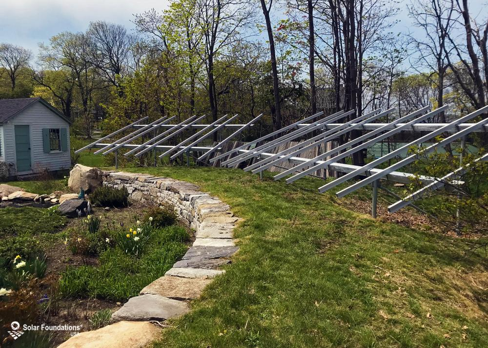 12.6 kW Ground Mount System in Nahant, MA. This featured system is built for (1) 4 panels high in landscape by 5 panel columns wide and (1) 4 panels high in landscape by 4 panel columns wide.