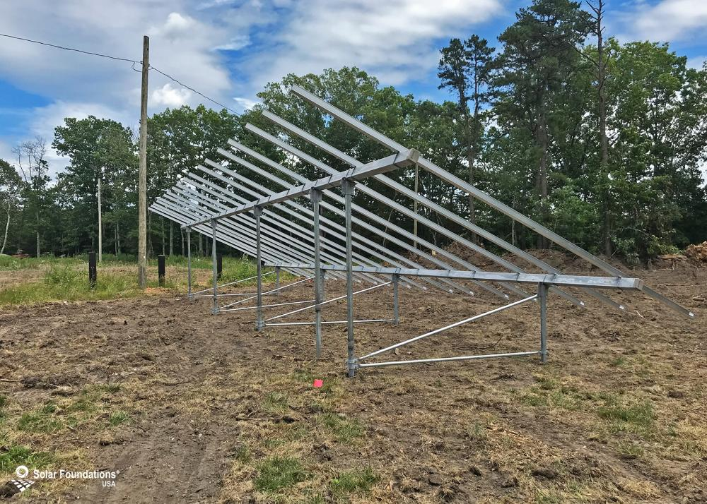 17.01 kW Ground Mount System in Egg Harbor Township, NJ. This featured system is built for 6 panels high in landscape by 9 panel columns wide.