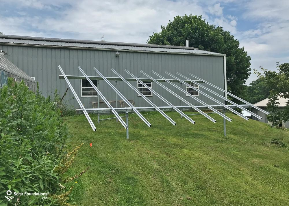8.55 kW Ground Mount System in Union Bridge, MD. This featured system is built for 6 panels high in landscape by 5 panel columns wide.