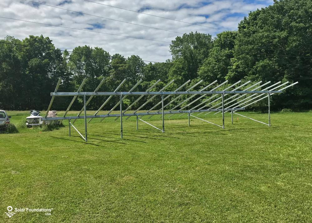 16.2 kW Ground Mount System in Washington Township, NJ. This featured system is built for 6 panels high in landscape by 9 panel columns wide.