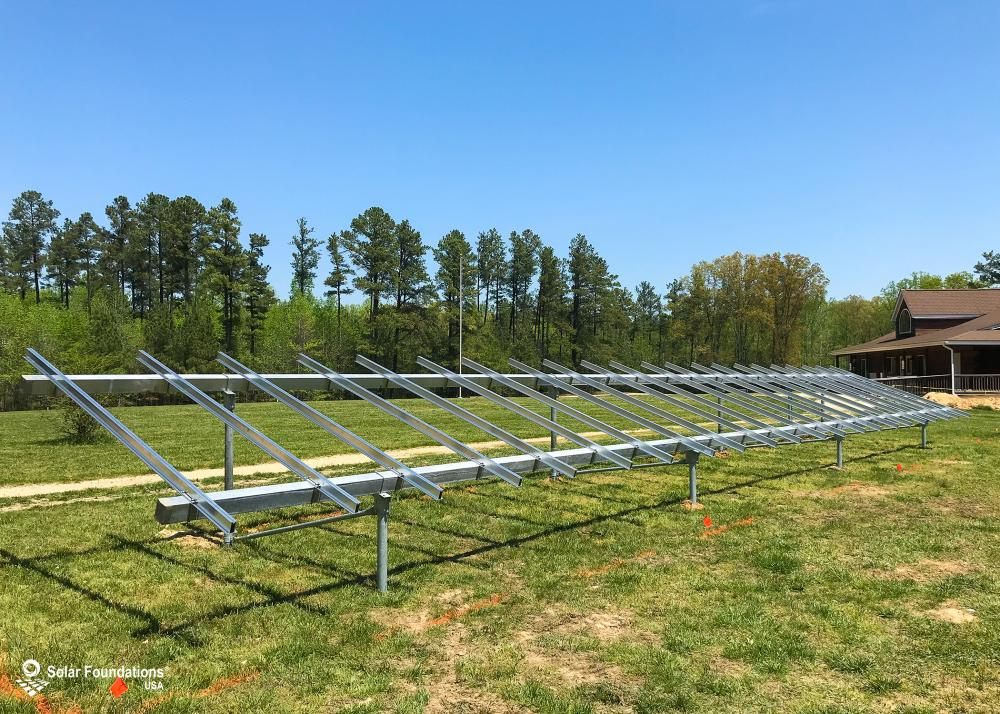 9.405 kW Ground Mount System in Hughesville, MD. This featured system is built for 3 panels high in landscape by 11 panel columns wide.
