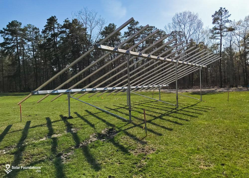 14.16 kW Ground Mount System in Buena, NJ. This featured system is built for 6 panels high in landscape by 8 panel columns wide.