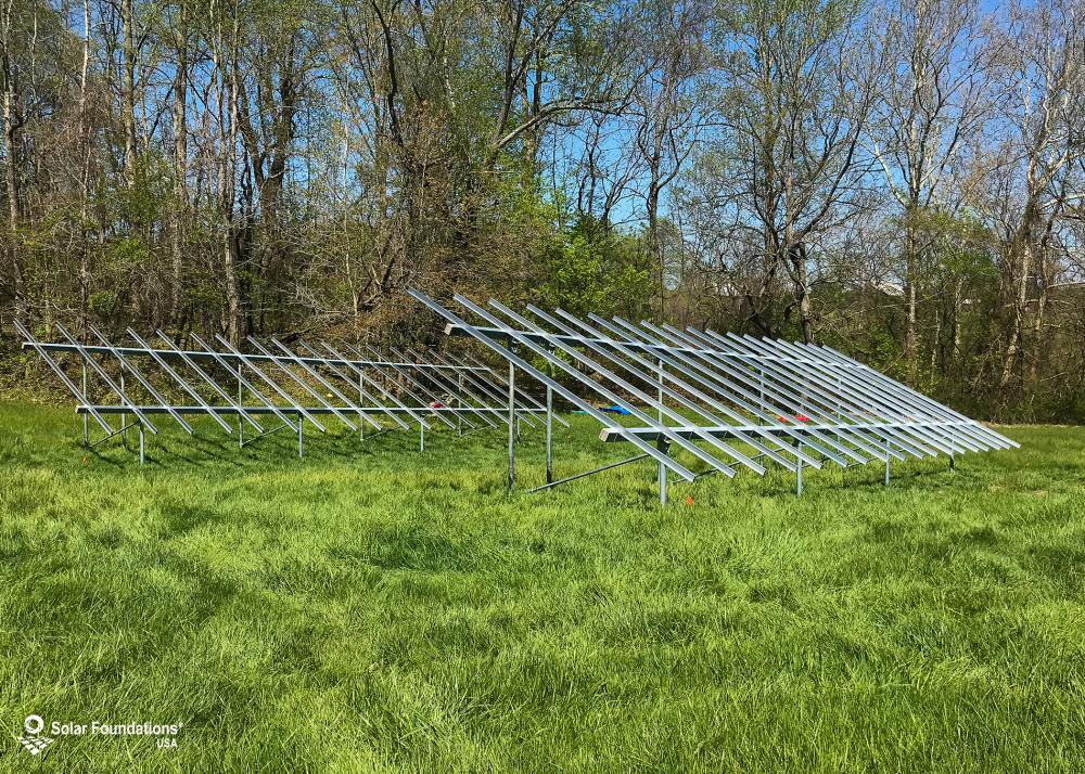 25.650 kW Ground Mount System in Dunkirk, MD. This featured system is built for (2) 5 panels high in landscape by 9 panel columns wide.