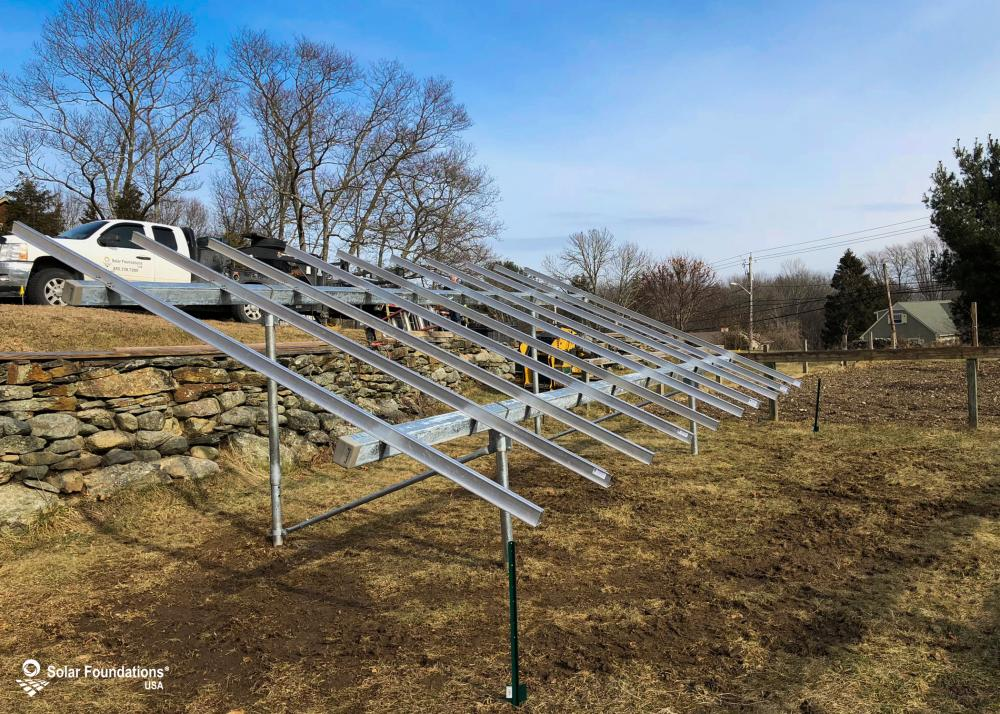 6.00 kW Ground Mount System in Somerset, MA. This featured system is built for 4 panels high in landscape by 5 panel columns wide.