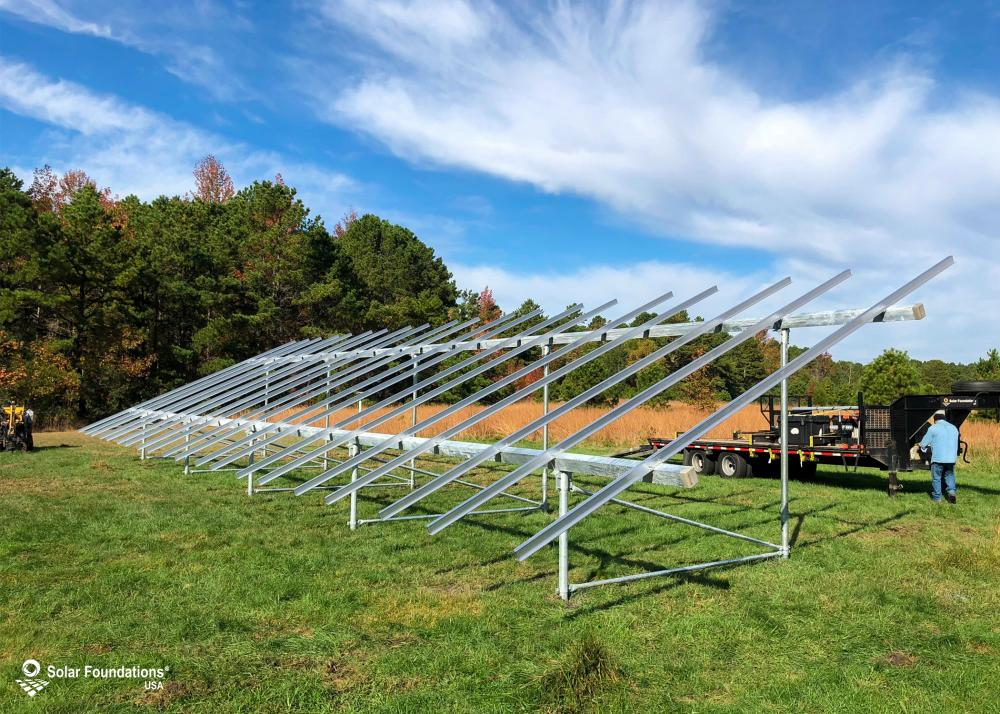 18.76 kW Ground Mount System in Weymouth, NJ. This featured system is built for 6 panels high in landscape by 10 panel columns wide.