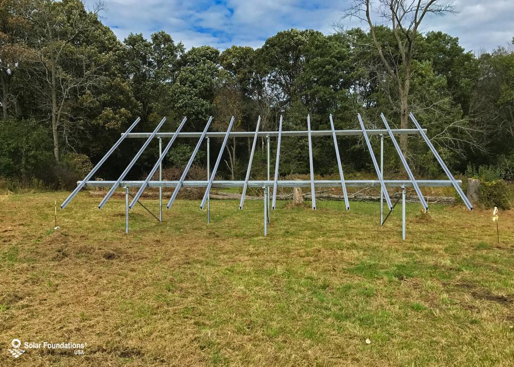 10.08 kW Ground Mount System in Altamont, NY. This featured system is built for 6 panels high in landscape by 6 panel columns wide.