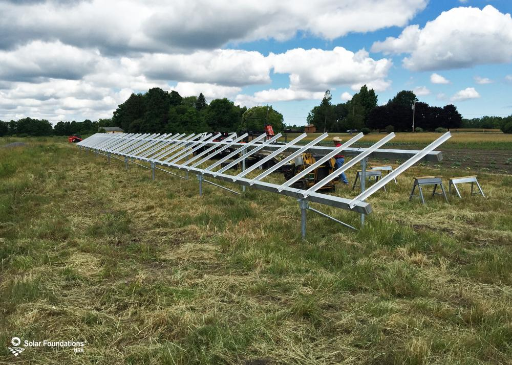 13.00 kW Ground Mount System in Lockport, NY. This featured system is built for 2 panels high in landscape by 20 panel columns wide.