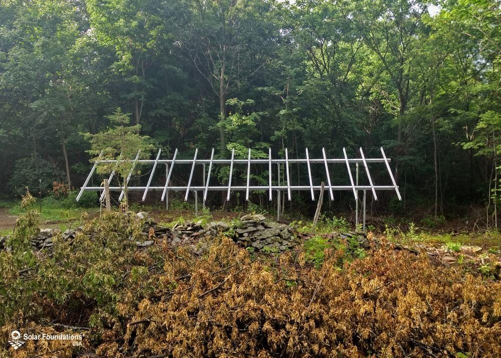 8.80 kW Ground Mount System in Granville, NY. This featured system is built for 4 panels high in landscape by 8 panel columns wide.