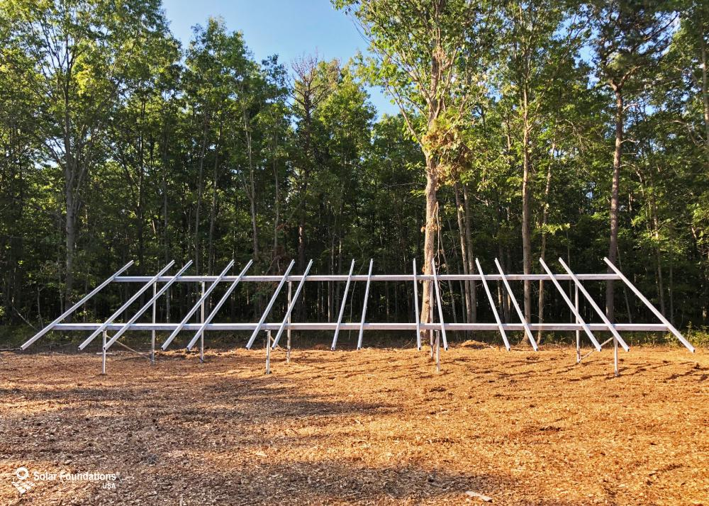 16.08 kW Ground Mount System in Egg Harbor City, NJ. This featured system is built for 6 panels high in landscape by 8 panel columns wide.