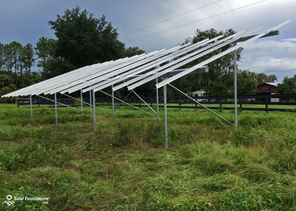 16.47 kW Ground Mount System in Chuluota, FL. This featured system is built for 6 panels high in landscape by 9 panel columns wide.