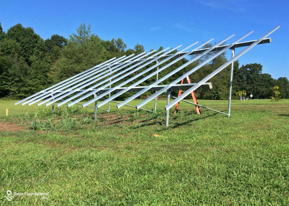 10.82 kW Ground Mount System in Woodleaf, NC. This featured system is built for 6 panels high in landscape by 6 panel columns wide.