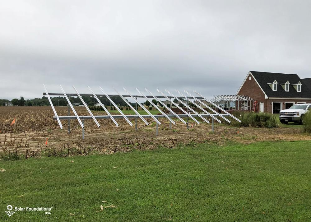 10.675 kW Ground Mount System in Ellendale, DE. This featured system is built for 5 panels high in landscape by 7 panel columns wide.