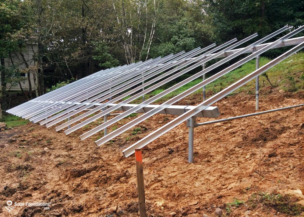 15.66 kW Ground Mount System in Long Pond, PA. This featured system is built for 6 panels high in landscape by 9 panel columns wide.